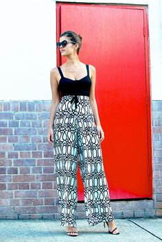 DIY Tribal print palazzo pants, crop bustier designed by me, Tony Bianco heels, Karen Walker Number One sunglasses, gold branch necklace.