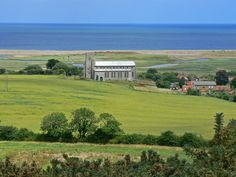 Salthouse Church and the view of the sea on the coast of North Norfolk