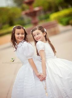 First Communion - great pose for sisters or friends receiving at the same time!