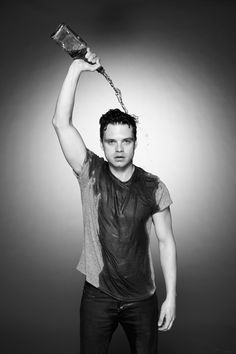 The Political Animals star gets messy with a bottle of scotch. It's for science!
