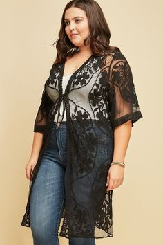 420f9fc243d Left three quarter view young plus size woman wearing black 3 4 sleeve  sheer mesh