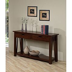 @Overstock - Ozark console table is constructed of durable rubberwood  Living room furniture showcases a walnut cherry color  Two-drawer accent table also features metal drawer glideshttp://www.overstock.com/Home-Garden/Ozark-2-drawer-Console-Table/4273824/product.html?CID=214117 $306.99.  54w x 16d x 32h 50 x 15 x 34