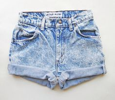 High waisted denim shorts, rolled legs.