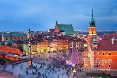 Old Town Castle Square of Warsaw in Poland illuminated at night, during Christmas time.