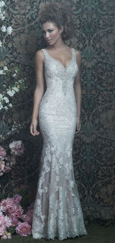 This delicate sheath features a vintage appeal in a silky slip dress and a sheer lace-covered overlay.