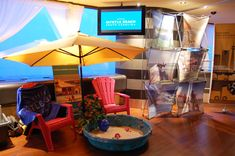 Beach umbrellas, lounge chairs, and a sandbox added to the beach-themed decor at the CN Tower. Garden Lounge Chairs, Beach Chairs, Kids Sandbox, Adirondack Chair Plans Free, Wrought Iron Patio Chairs, Farmhouse Dining Chairs, Beach Umbrella, Beach Themes, Winter Time