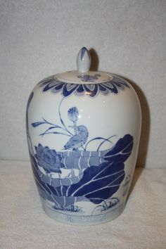 """This is a gorgeous ceramic porcelain oriental vase with hummingbird design. It measures approx: 10 3/4"""" tall with lid x 5 1/4""""D base x 2.5""""D opening. It is in xcellent condiiton. Made in China stamped in blue on bottom. $55 FREE SHIPPING TO US RESIDENCE. Please email me with any questions. Thank you Vases For Sale, Hummingbird, Oriental, Porcelain, Blue And White, Mint, Stamp, Base, Ceramics"""