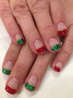 French Manicure done with Bio Sculpture Gel colours: #63 - Moulin Rouge & #2022 - Emerald Touch.  Added red and green glitter for an extra punch and outlined with gold striping tape