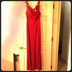"""Gorgeous red evening gown Gently worn (only once) long red evening gown. Heavy jersey material. Beautiful draping style in front & back, twisting at shoulders.   I got so many compliments when I wore this. Will never go out of style!   Bust 16"""". Waist 15"""". Hips 19"""". Full length 58"""".  Made in the USA. 100% polyester. Dry clean only. Recently dry cleaned.   Slight tear at seam at the bottom of zipper. Easily fixable (I had finger surgery or I would fix it first).   Trades PP ✔️Offers welcome…"""
