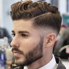 Low Fade with Hard Part and Wavy Pomp