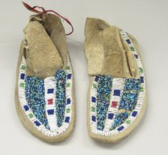 Probably Sioux, Native American. Pair of Boy's Moccasins, early 20th century. Rawhide, beads, 7 1/2 x 2 3/4 in. (19.1 x 7 cm).