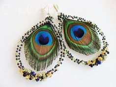 Peacock earrings: Interesting with beaded wire around feather