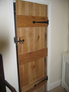 Solid Oak Internal Door - 3 ledged door also known as the cottage door.  Pre finished in a clear matt to give a natural look.  The hinges and latch really finish  off the cottage look.