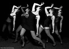 """Carrie Madsen (center) as Velma Kelly leads the ensemble in """"All That Jazz"""" in Hillbarn Theatre's production of the Kander and Ebb musical """"Chicago"""""""
