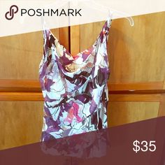 DVF sleeveless blouse in floral pattern. 100% silk lining and shell is 95% silk 5% Lycra . Only worn once , looks great under a jacket Diane von Furstenberg Tops Blouses