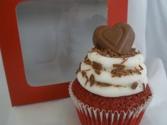 Red Velvet Cupcake topped with cream cheese icing, chocolate shavings, and a chocolate heart.