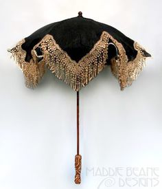 This antique Edwardian era black lace gold jewel handle parasol dates from 1910