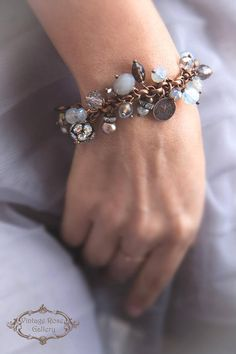 Boho chic Bracelet - Rustic Bracelet - Charm Bracelet - Versatile Bracelet - Christmas Gift - Gemstones & Crystals Rustic & Glam A unique Rustic Charm bracelet with multi tones of grey semi precious stones, crystals , vintage pearls and bronze charms . I used the grey tones of