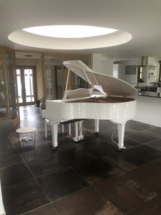 White Wilh Steinmann Baby Grand fitted with Pianodisc Wireless System from Chiltern Pianos, Bovingdon.