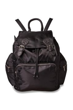 The Heart Breaker Backpack features a smooth, sleek body fabric with exposed metal zip detailing and leather look trims including double buckle flap closure. Composition: 100% Synthetic Materials