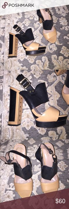 Vince Camuto Heels tan and black Tan and black with gold hardware platform Vince Camuto heels. 5 1/2 inch heel. Easy to walk in with platform. Size 9.5 Vince Camuto Shoes Heels