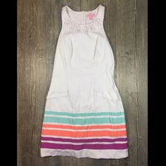 Lilly Pultizer white & stripe jeweled dress Lilly Pultizer white and stripe jeweled collar waffle print dress. Zipper in back. Faux pockets. 34 inches long. Missing some jewels around the collar. Faux pockets. Slip attached. Cotton spandex. Tag reads size 0. Lilly Pulitzer Dresses
