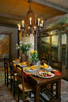 lt;pgt;A mural in the wine cellar depicts the Château Haut-Brion wine estate in Bordeaux, while a candle-burning chandelier, antique farmhouse table from the South of France and reclaimed brick floors continue the theme.lt;/pgt;