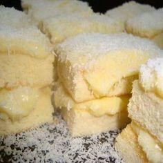 TORTA HELADA DE LECHE EN POLVO INGREDIENTES Masa: 4 claras 1 pizca de sal. 1 taza de requesón helada. 4 yemas. 3 tazas de harina de trigo. 2 tazas de azúcar. 1 cucharada de levadura en polvo. Almíbar: 200 ml de leche de coco. 100 ml de leche condensada. 50 ml...