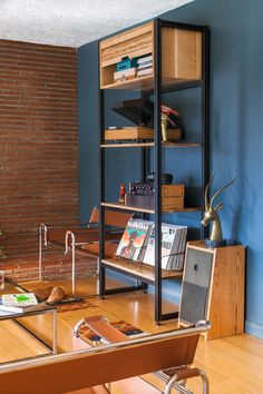 modular open shelving unit from Tanner Goods, made of oak, walnut, and aluminum for the living room