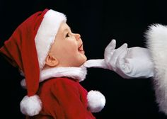 The Magic Touch!  It must be mommy in the suit since, most babies scream when the are with Santa.