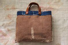 This is Japanese small boro bag, made of vintage japanese sakabukuro textiles. Sakabukuro have a lot of sashiko stitching repaired holes. Lining Japanese Cotton, Vintage Japanese, Basket Bag, Fabric Bags, Boro, Handmade Bags, Real Leather, Indigo, Reusable Tote Bags