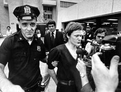 Philippe Petit being arrested after tightrope walking across the World Trade Centers. 1974 [2000x1529]