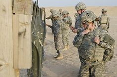 Spc. Elizabeth Laskey, all source intelligence analyst, 2nd Special Troops Battalion, 2nd Armored Brigade Combat Team, 4th Infantry Division, reviews her three-round shot group during the weapons qualification range for the 2014 U.S. Army Central Soldier/NCO of the Year competition at Camp Buehring, Kuwait, #USArmy