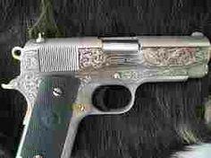 Chrome scroll artwork handgun