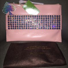 """Kate spade all aglow rosydawn Clutch Brand new Kate spade all aglow """"swarovski crystal""""rosydawn clutch 100% authentic bag with original tags limited edition bag  A limited edition collection of pieces made with swarovski elements """"the crème de la crème of sophisticated shine""""   3 card holder slots  Along with zipper pocket inside  Dust bag kate spade Bags Clutches & Wristlets"""