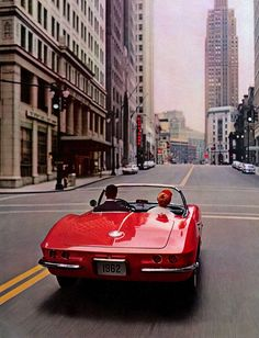 NYC, 1962. Rush hour for convertible red cars
