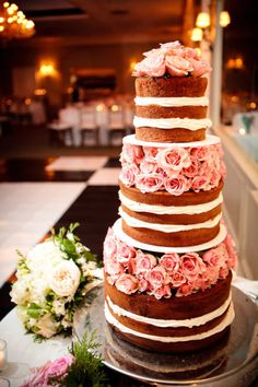 Naked cake with tiers separated by flowers