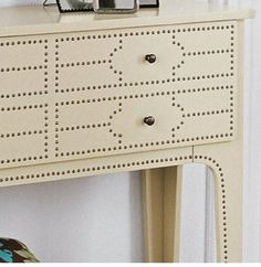 nailhead adds interest to a plain piece of furniture