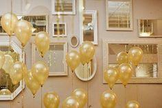 gold balloons + mirrors as a backdrop