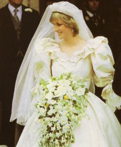 Princess Diana looking so beautiful on her wedding day. All the people waiting outside finally get a glimpse of their new Princess.  ~~July 29,1981.~~