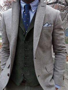Long-torso-ed, many-buttoned, corduroy VEST.  Yes, please.
