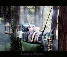 ethereal dreamy bed suspended from trees in forest, accompanied by tree suspended bedside table with lamp, earthy, purple lavender blue bed spread, tree bed