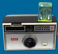 Istill have this camera. the little button on the front ejects the flash cube.