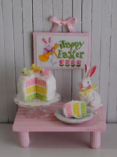 "Miniature Easter Cake, A ""Happy Easter"" Wall Hanging, And A Cute White Bunny"