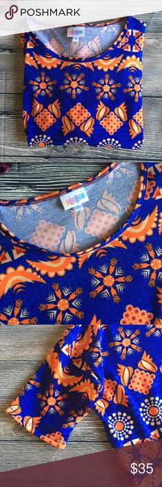 LuLaRoe Irma hi low tunic orange/blue size medium Meet Irma. She's a high-low tunic from LuLaRoe. Fitted short sleeves and a bright coloring of oranges and blues will chase away your Winter doldrums and make her the perfect companion to your favorite leggings. Is she your unicorn? Like new. Size medium (L3) Offers warmly received. LuLaRoe Tops Tunics