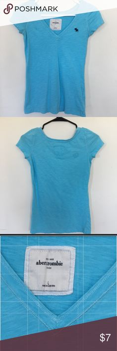 Abercrombie Kids T-shirt.  Girl's size (L). Abercrombie Kids T-shirt.  Girl's size (L). Short sleeved. V- neck. Beautiful turquoise color. Great condition. Abercombie Kids Shirts & Tops Tees - Short Sleeve