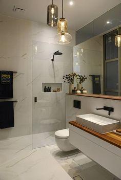 Master Bath - Marble-look floors & walls, white floating vanities, wood countertops, white vessel sinks