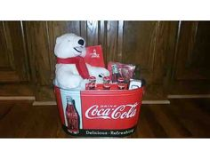 This auction is for the Coca Cola Lover or Memorabilia Collector! This basket includes:  Four (4) World of Coca-Cola General Admission Passes Coca-Cola 10