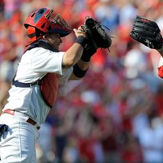 ST. LOUIS, MO - SEPTEMBER 3: Jason Motte #30 of the St. Louis Cardinals celebrates with Yadier Molina #4 after closing out a game against the New York Mets at Busch Stadium on September 3, 2012 in St. Louis, Missouri. (Photo by Jeff Curry/Getty Images)