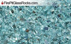 Glass Fire Rocks http://www.firepitglassrocks.com/images/new_images/glass/glass/caribbean-teal.htm
